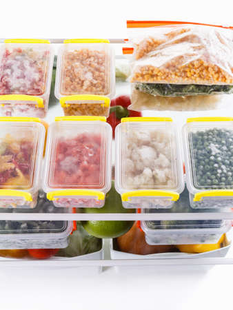 food storage: Frozen food in the refrigerator. Vegetables on the freezer shelves. Stocks of meal for the winter.