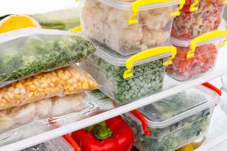 freezer: Frozen food in the refrigerator. Vegetables on the freezer shelves. Stocks of meal for the winter.