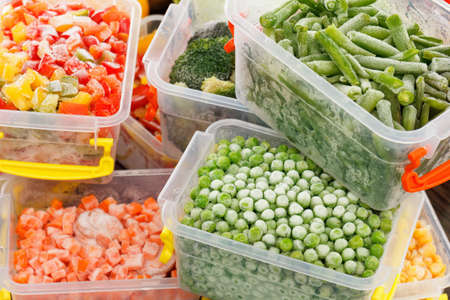 Frozen foods recipes vegetables in plastic containers. Healthy freezer food and meals. Imagens