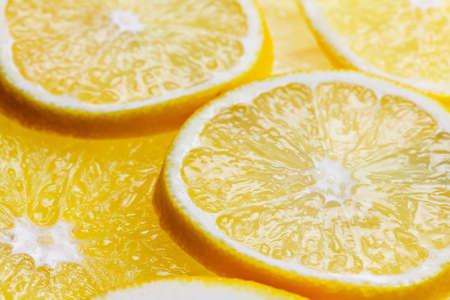 Slices of citrus fresh fruits background close up