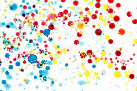 Abstract multicolor background. Bubbles of paint and ink on a white, pattern of drop. Random art.