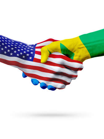 Flags United States and Saint Vincent and the Grenadines countries, handshake cooperation, partnership and friendship or competition isolated on white Stock Photo