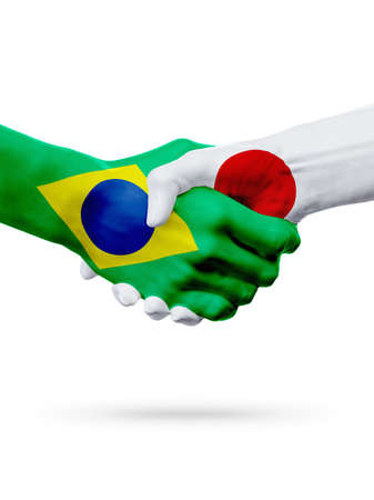 Flags Brazil, Japan countries, handshake cooperation, partnership, friendship or sports team competition concept, isolated on white