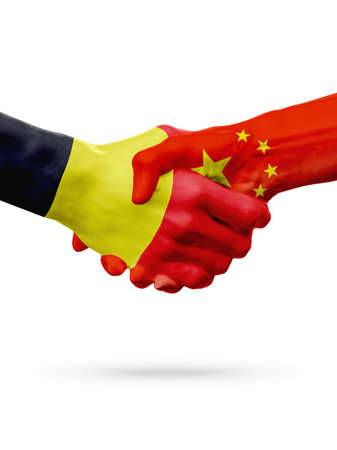 Flags Belgium, China countries, handshake cooperation, partnership, friendship or sports team competition concept, isolated on white Stock Photo