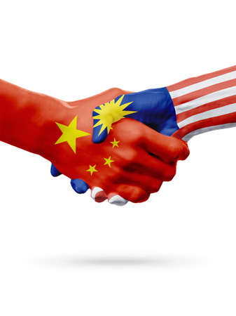 malaysia culture: Flags China, Malaysia countries, handshake cooperation, partnership, friendship or sports team competition concept, isolated on white