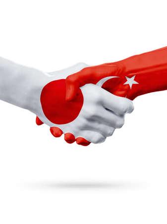 bandera japon: Banderas Japón, países de Turquía, cooperación de apretón de manos, asociación, amistad o concepto de competencia de equipo deportivo, aislado en blanco Foto de archivo