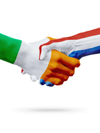 Flags Ireland, Netherlands countries, handshake cooperation, partnership, friendship or sports team competition concept, isolated on white Stock Photo