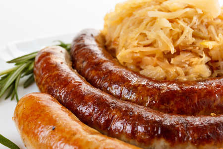Delicious octoberfest menu, plate of sausages and sauerkraut. Oktoberfest meal.