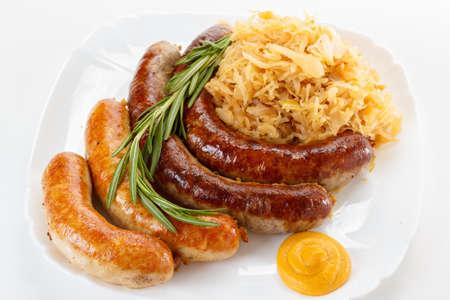 kohl: Traditional Octoberfest menu, plate of sausages and sauerkraut. Oktoberfest meal.