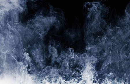 Abstract pattern of Billowing white smoke on a black background. Waves of mist and clouds.