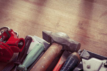 old items: Old tools on a wooden background with copy space. Overhead view. Stock Photo
