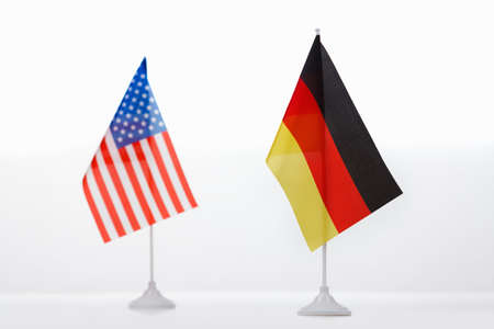 USA and Germany small flag on white background close-up