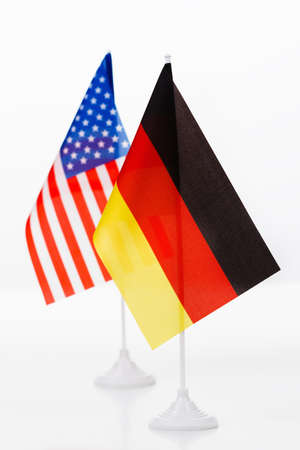 allies: USA and Germany small flag on white background close-up