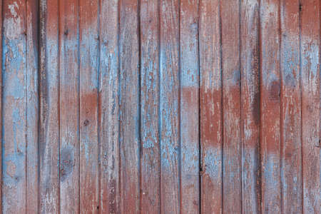 spall: Background of old wooden board with peeling cracked red paint Stock Photo
