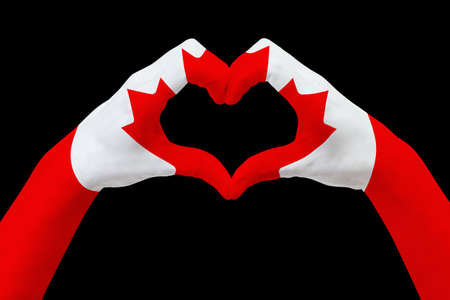 Hands flag of Canada, shape a heart. Concept of country symbol, isolated on black. Abstract 3d illustration graphic, design with pattern and texture. Reklamní fotografie