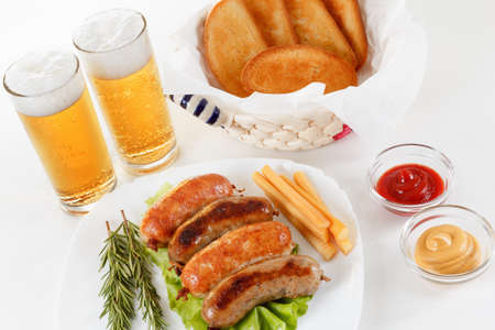 Oktoberfest traditional beer food menu. Fried sausages with toast and mustard. White background