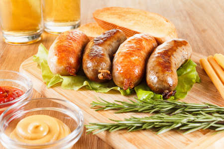 Oktoberfest traditional beer food menu. Fried sausages with toast and mustard. Wooden background