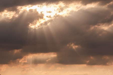 dramatic sky sunset, sun through the clouds sunlight, summer nature landscape Stock Photo