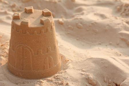 Sand castle sea construction sun spade beach. Stockfoto