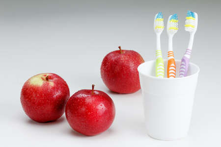 apple with a toothbrush, on white. healthy dental care