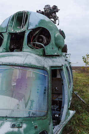 Old broken green russian helicopter on the field Stock Photo