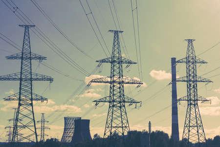 high tech: Power line technology voltage electricity pylon landscape.