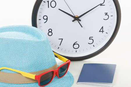 Vacancy concept. Clock, passport and sunglasses on hipster hat Stock Photo