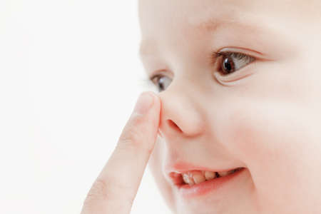 tender lips and nose and finger of a child baby wake up, closeup Stock Photo