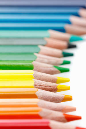 Group of colorful vibrant colored pencils on white background Stock Photo