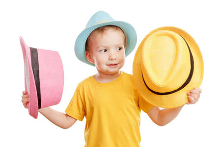 Cheerful smiling dancing child boy in a hat isolated on white Stock Photo