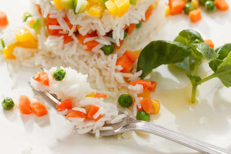 Vegetarian food, rice salad with vegetables, healthy eating Stock Photo