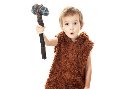 Cute cheerful naughty child playing with axe. Humorous concept ancient caveman isolated on white background