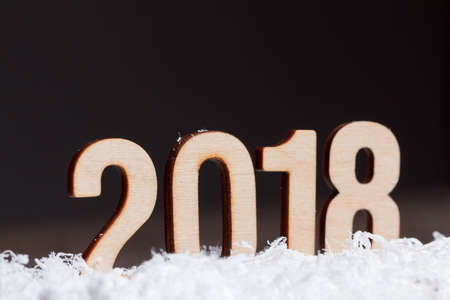 Christmas New year 2018 made with wooden on black background, copy space.