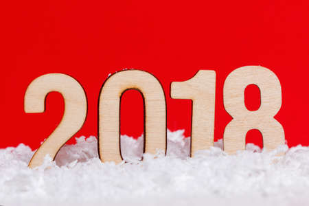 Christmas New year 2018 made with wooden on red background, copy space.