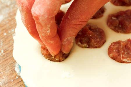 Process of cooking traditional Italian ravioli dumplings.