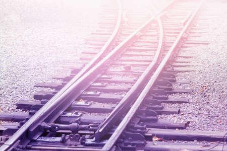 Empty Railroad in fog with diagonal railway background Stock Photo