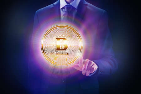 Crypto currency block chain, business mining concept design. Businessman and coin in hand as bit finance of e-commerce or e-banking. Stock Photo