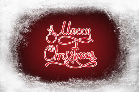 Merry Christmas text on red background and hoarfrost snow frost on xmas window pattern copy space Stock Photo