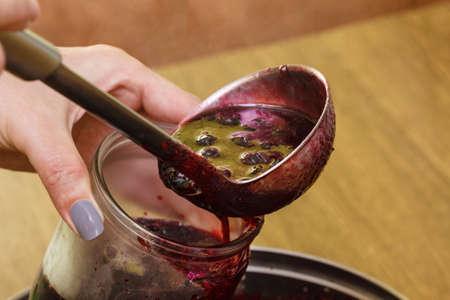 Jam cooking berries fruit food making fresh summer. 免版税图像