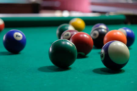 Billiard chelk and pool table background closeup.