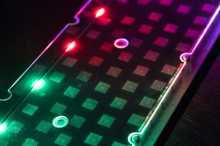 Closeup of laptop keyboard led component inside illumination, backlit keyboard, backlight pc key inside Stock Photo