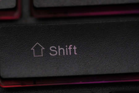 Closeup of laptop keyboard illumination, backlit keyboard, backlight pc key