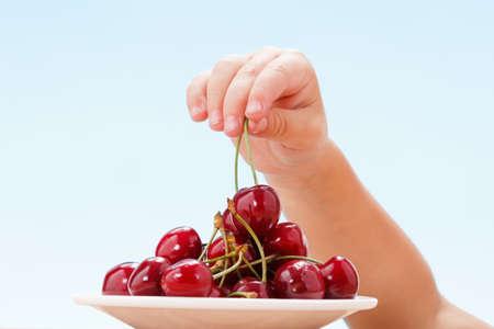 Child hand robbing berries food dessert fruit.