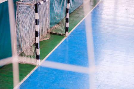 Football defocused gate field Small, Futsal ball field in the gym indoor, Soccer sport field