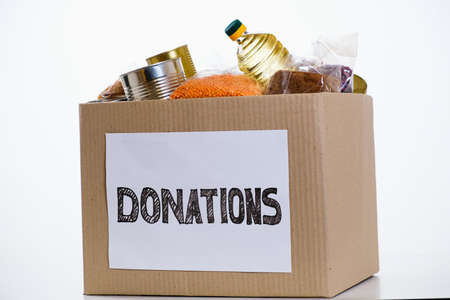 Food in a donation cardboard box, isolated on white background