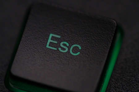 Escape Key on computer keyboard abandon, complete, quit, leave concept