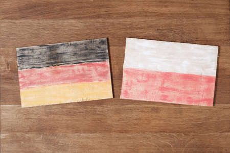 Germany and Poland flag, concept cooperation competition friendship on wood background. Grunge wall