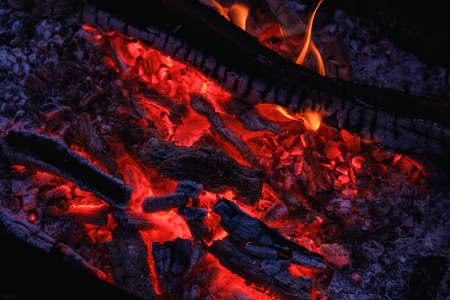 Burning coals at night ,Decaying charcoal, barbeque season