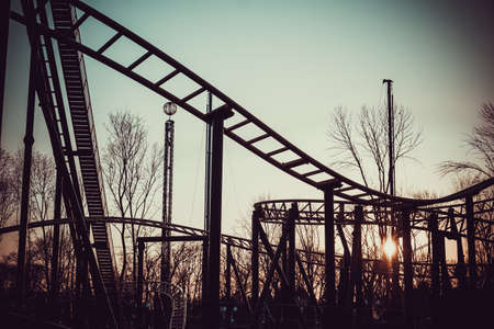 Scary Fun On An Upsidedown Roller Coaster on setting sun sunset