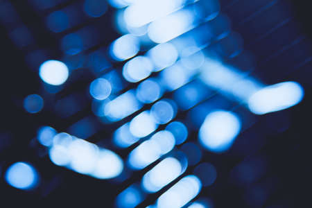 abstract blue blur of city lighting digital lens flare glare, blinds light shadow background Stock Photo